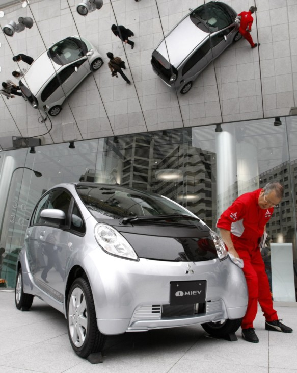 Mitsubishi Motors Corp's the i-MiEV electric vehicles are displayed in Tokyo