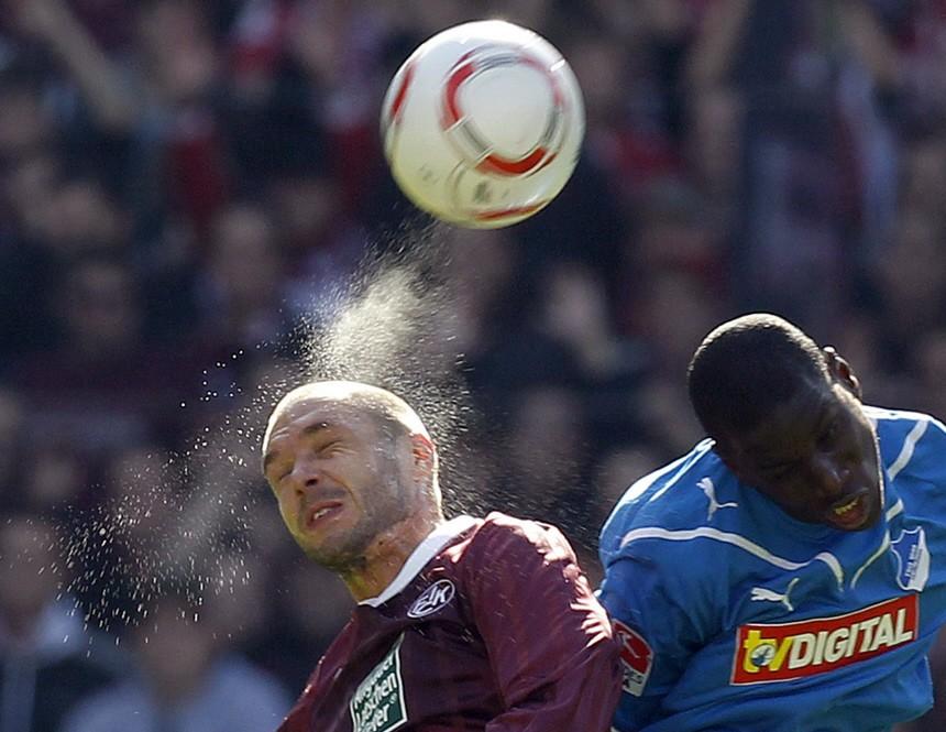 Kaiserslautern's Tiffert challenges Hoffenheim's Ba during their German Bundesliga soccer match in Kaiserslautern