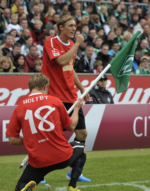 Mainz 05's Risse and Holtby celebrate after scoring against Werder Bremen during their German Bundesliga first division soccer match  in Bremen