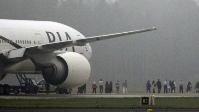 Passengers are evacuated from a Pakistan Airlines jet which landed at Arlanda Airport near Stockholm following a bomb threat