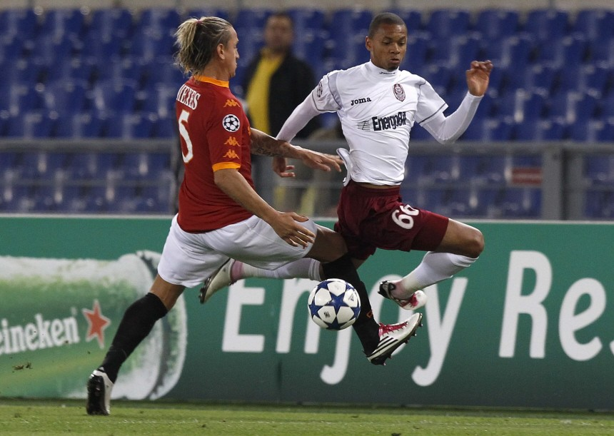 AS Roma's Mexes challenges CFR Cluj's Edimar during their Champions League Group E soccer match in Rome