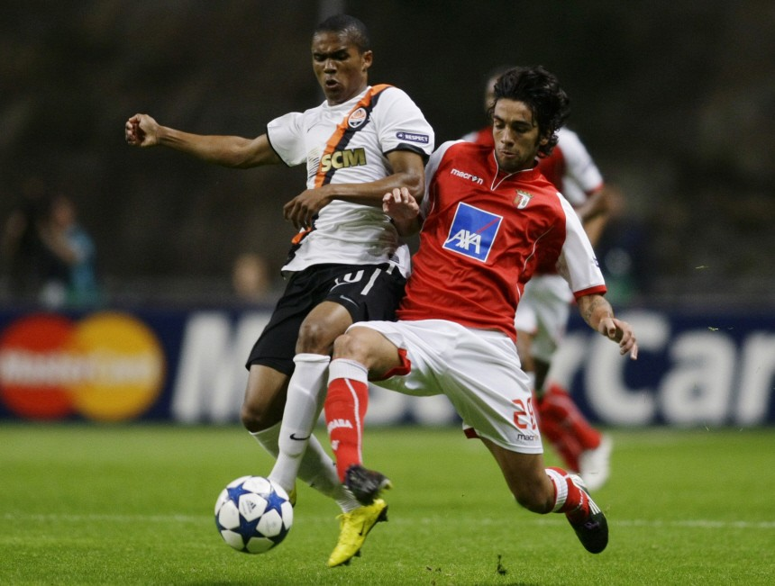 Sporting Braga's Azevedo battles for the ball with Shakhtar Donetsk's Costa during their Champions League Group H soccer match at the Braga City stadium