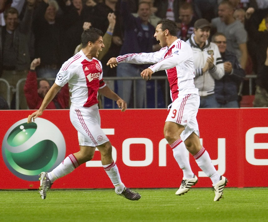 Ajax Amsterdam's Luis Suarez and Mounir El Hamdaoui celebrate a goal against AC Milan during their Champions League Group G soccer match in Amsterdam