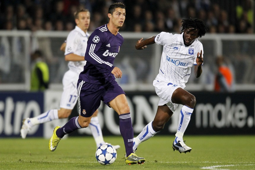 Real Madrid's Cristiano Ronaldo runs with the ball in front of AJ Auxerre's Delvin Ndinga during their Champions League Group G soccer match at Abbe Deschamps' stadium in Auxerre