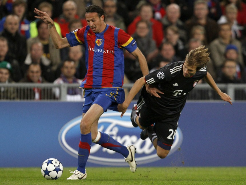 FC Basel's Streller fights for the ball with Bayern Munich's Badstuber during their Champions League Group E soccer match in Basel