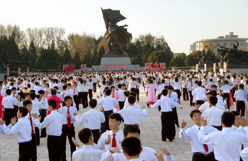 Students dance at the Monument to the Victorious Fatherland Liberation War in Pyongyang