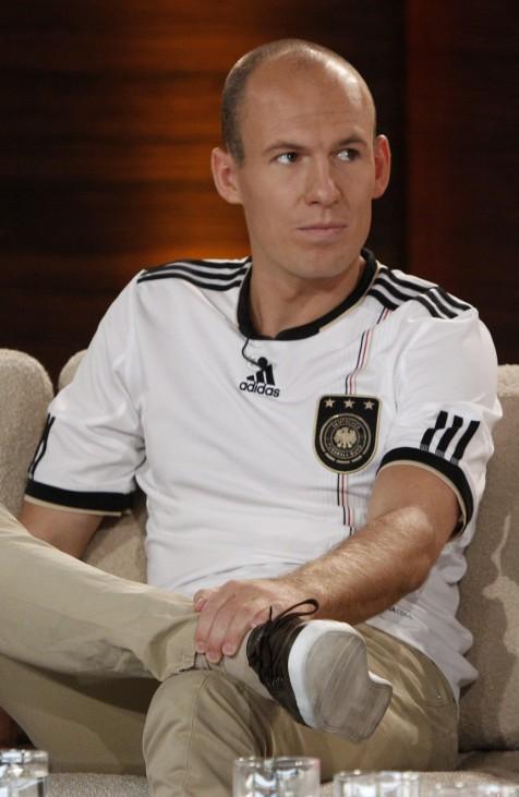 Bayern Munich's Robben sits in German national soccer team shirt in game show 'Wetten Dass' (Bet it...?) in Munich