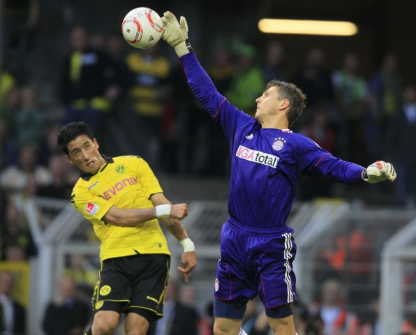 Bayern Munich's goalkeeper Butt makes a save in front of Borussia Dortmund's Sahin of Turkey during their German first division Bundesliga soccer match in Dortmund