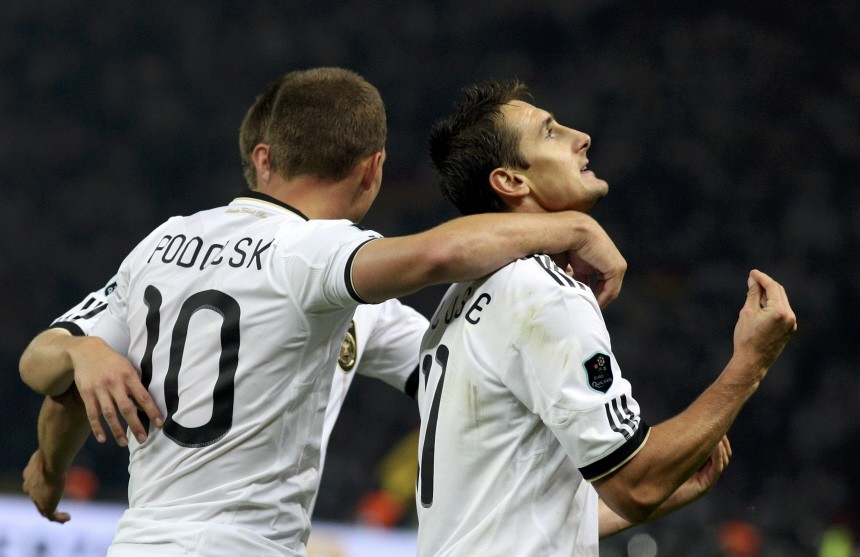 Germany's Klose and Podolski celebrate during the Euro 2012 qualifying soccer match against Turkey at the Olympic stadium in Berlin