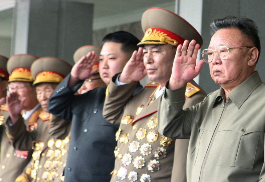 Kim Jong-il and Kim Jong-un watch a grand military parade in Pyongyang