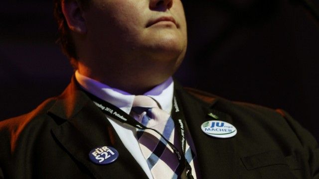 A delegate wears button supporting controversial S21 transport development project as he  attends Junge Union  congress in Potsdam