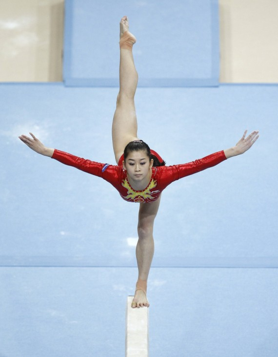 Jiang of China performs on the beam during the women's team final of the Artistic Gymnastics World Championships in Rotterdam