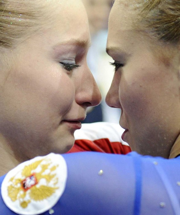 Russia's Semenova and team mate Afanasyeva celebrate their victory in the women's team final of the Artistic Gymnastics World Championships in Rotterdam