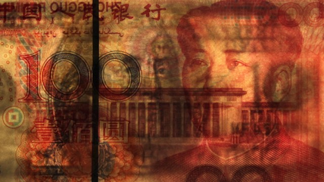 A U.S. $100 banknote is placed on a 100 yuan banknote in this photo illustration taken in Beijing