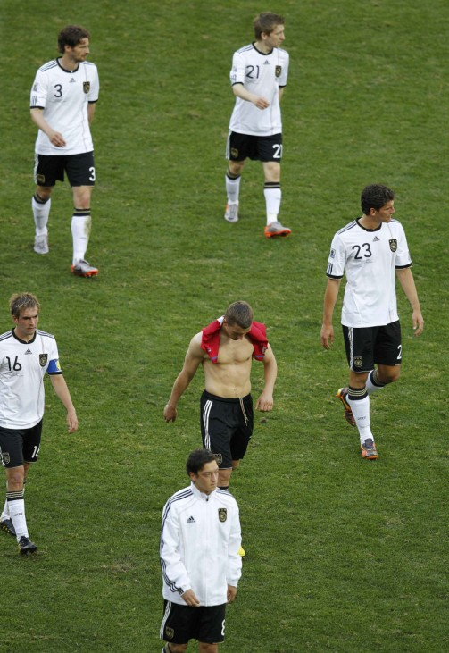 Germany's Friedrich Marin Gomez Podolski Ozil and Lahm walk dejectedly from pitch after defeat by Serbia in 2010 World Cup Group D soccer match in Port Elizabeth