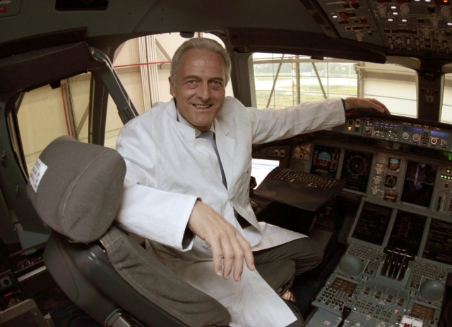 German Transport Minister Ramsauer poses in cockpit of Airbus A380 during visit at Airbus facility in Finkenwerder