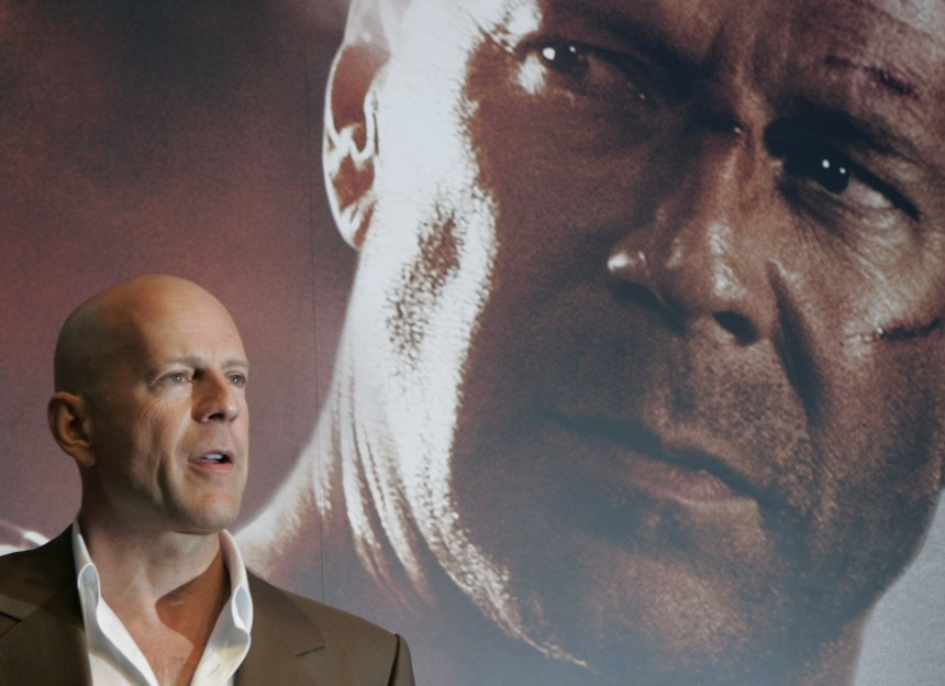 Actor Bruce Willis poses during a news conference for the movie 'Die Hard 4.0'