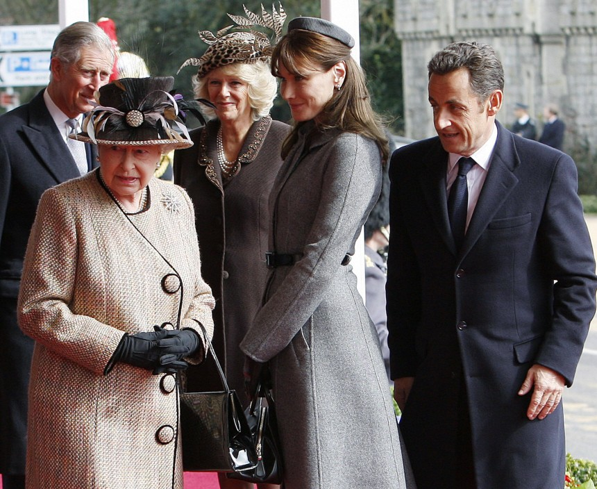 French President Nicolas Sarkozy and first lady Carla Bruni are greeted by Britain's Queen Elizabeth in Windsor, southern England
