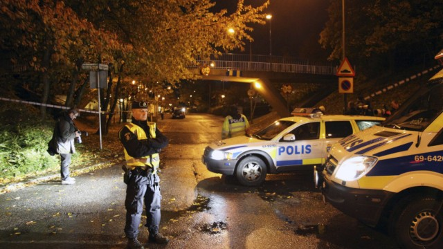 Police work at the scene where two women with immigrant backgrounds where shot through an apartment window in Malmo