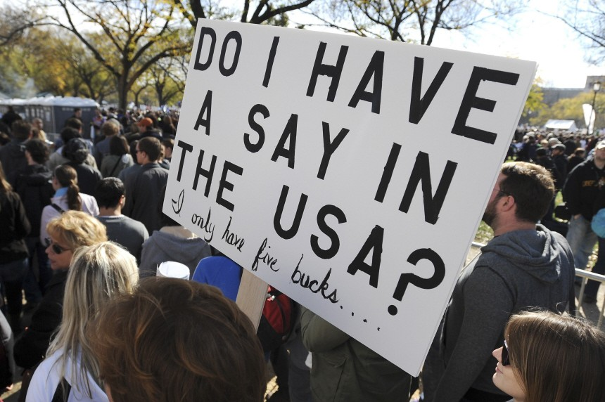 A man holds a sign at the 'Rally to Restore Sanity and/or Fear' on the National Mall in Washington