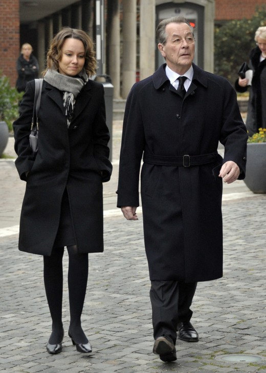 Former leader of Germany's SPD Muentefering and his wife Michelle arrive for funeral service for Loki Schmidt in Hamburg