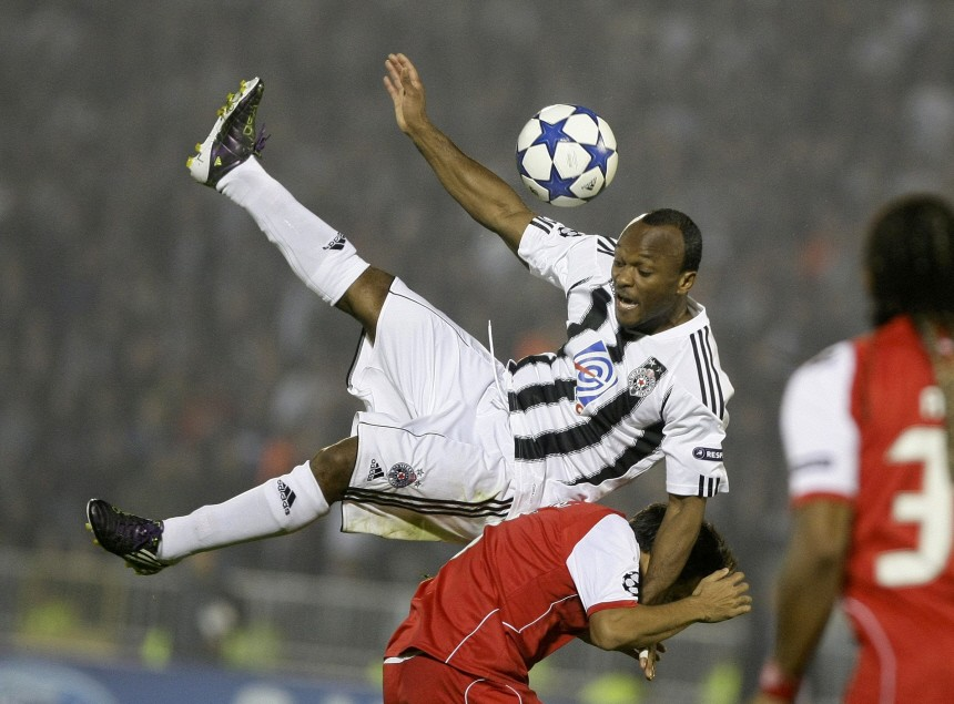 Partizan Belgrade's Moreira competes for ball with Braga's Mossoro during their Champions League Group H soccer match in Belgrade