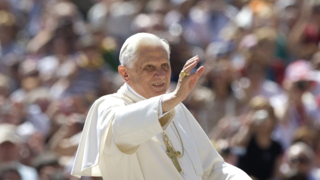 Pope Benedict XVI waves as he arrives to lead his general audience is Saint Peter's Square at the Vatican