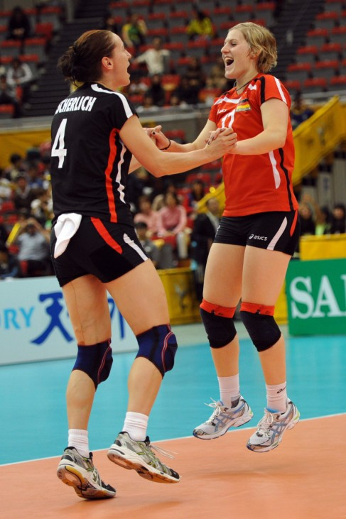 Germany's Tzscherlich and Thomen celebrate after defeating the Czech Republic during their second round volleyball match in Nagoya