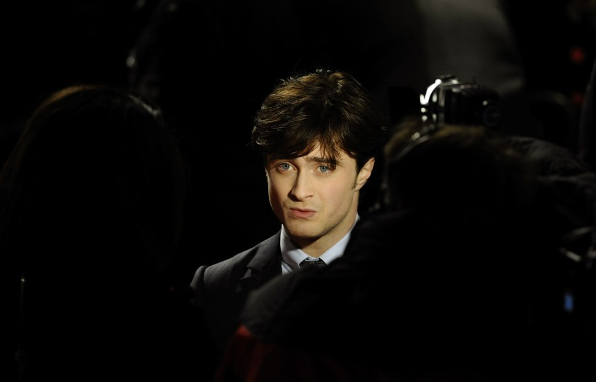 Britain's Radcliffe poses as he arrives for the world film premiere of 'Harry Potter and the Deathly Hallows: Part 1' in London