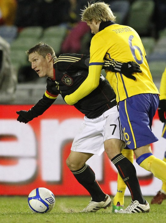 Germany's Schweinsteiger fights for the ball with Sweden's Toivonen during their international friendly soccer match at Ullevi Stadium in Gothenburg