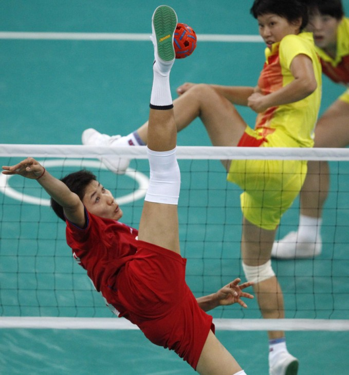 Thailand's Tidawan kicks the ball during the women's team sepak takraw final against China at the 16th Asian Games in Guangzhou