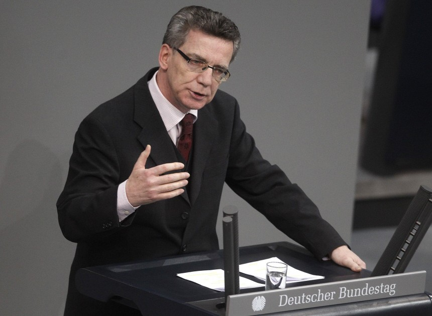 German Interior Minister de Maiziere delivers speech during Bundestag session in Berlin