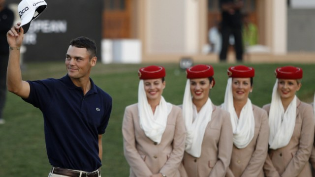 Germany's Martin Kaymer waves to spectators during the trophy ceremony after the final round of the Dubai World Championship European PGA golf tournament in Dubai