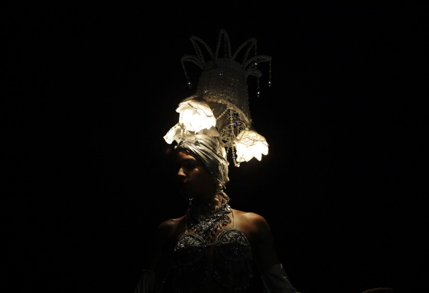 A dancer wearing lamps on her head performs during an AIDS awareness event in Havana