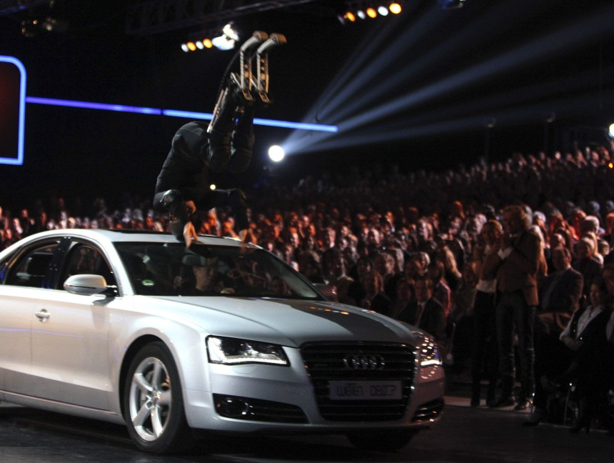 Koch jumps over a car during the German game show 'Wetten Dass' (Bet it...?) in Duesseldorf,