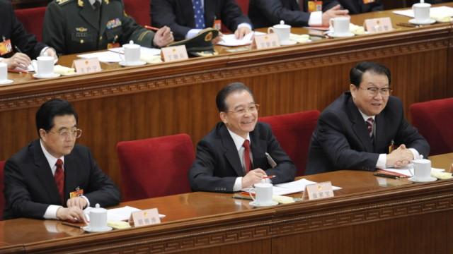 Attacken auf Google: Chinas Führung hat stets abgestritten, hinter den Hackerangriffen auf Google zu stehen. Nun bringen US-Diplomaten in Depeschen die Kader um Präsident Hu Jintao, Premier Wen Jiabao und das Politbüro-Mitglied Li Changchun (von links) in Verbindung mit den Attacken.