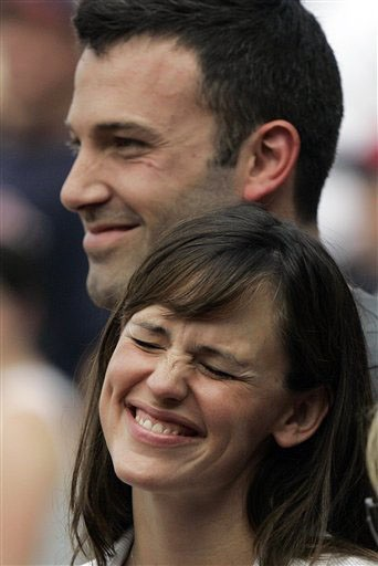 Actors Ben Affleck and Jennifer Garner smile while next to the Boston Red Sox dugout prior to the start of their baseball game against the New York Yankees at Fenway Park in Boston Saturday, June 2, 2007. (AP Photo/Elise Amendola)