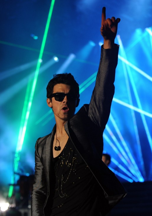 COSTA RICA, San Jose : US singer Joe Jonas, member of The Jonas Brother's group, performs at the stage at the Ricardo Saprissa Stadium during a concert in San Jose on October 26, 2010.AFP PHOTO/ Yuri CORTEZ
