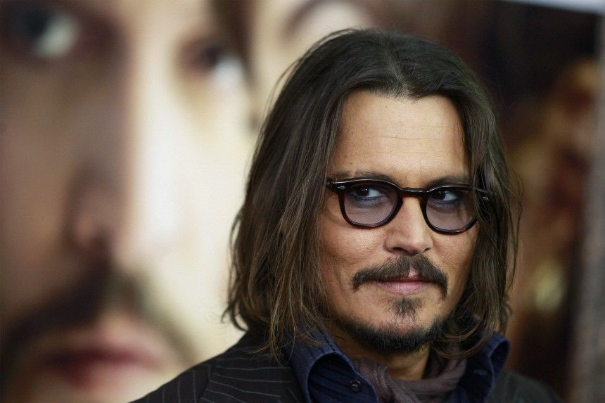 Cast member Johnny Depp arrives for the premiere of 'The Tourist' in New York