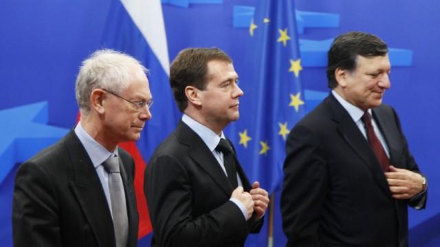 Russia's President Dmitry Medvedev is welcomed by European Council President Herman Van Rompuy in Brussels