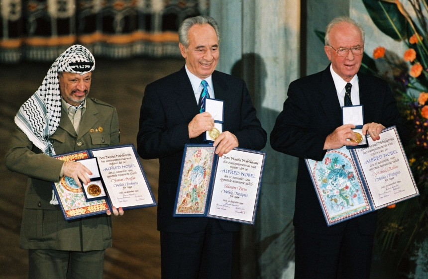 File photograph of Palestinian President Arafat, Israel's Perez and Israeli Prime Minister Rabin showing their Nobel Peace Prize in Oslo
