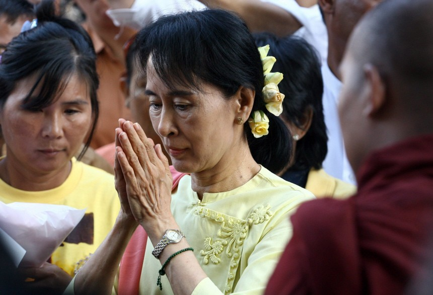 Aung San Suu Kyipart in public religious services for the first t