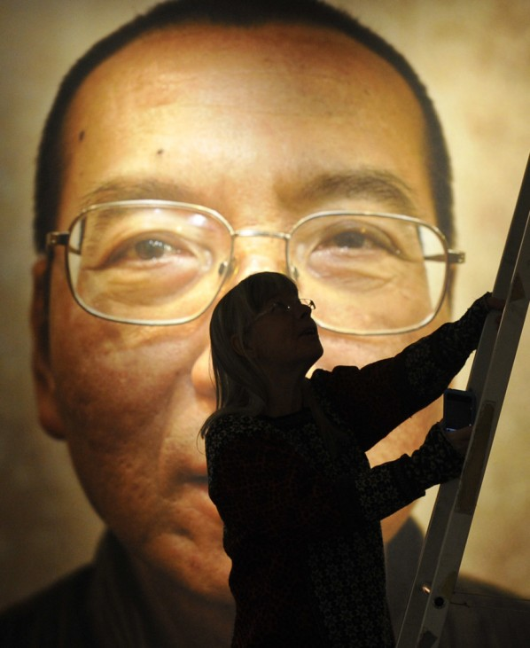 Workers prepare the Nobel Peace Prize laureate exhibition 'I Have No Enemies' for Chinese dissident Liu Xiaobo at the Nobel Peace Center in Oslo