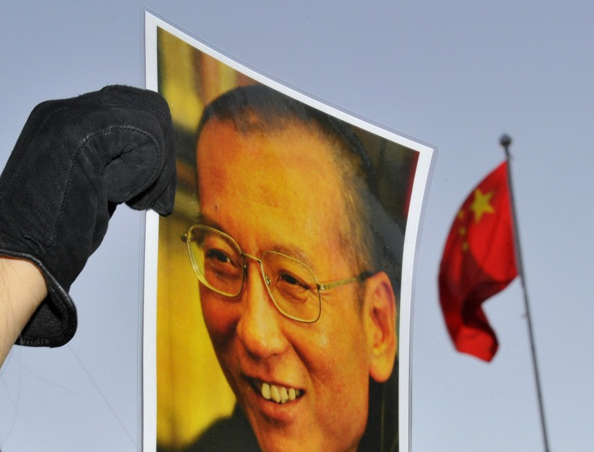 A protester holds an image of to jailed dissident Liu outside of the Chinese Embassy in Oslo