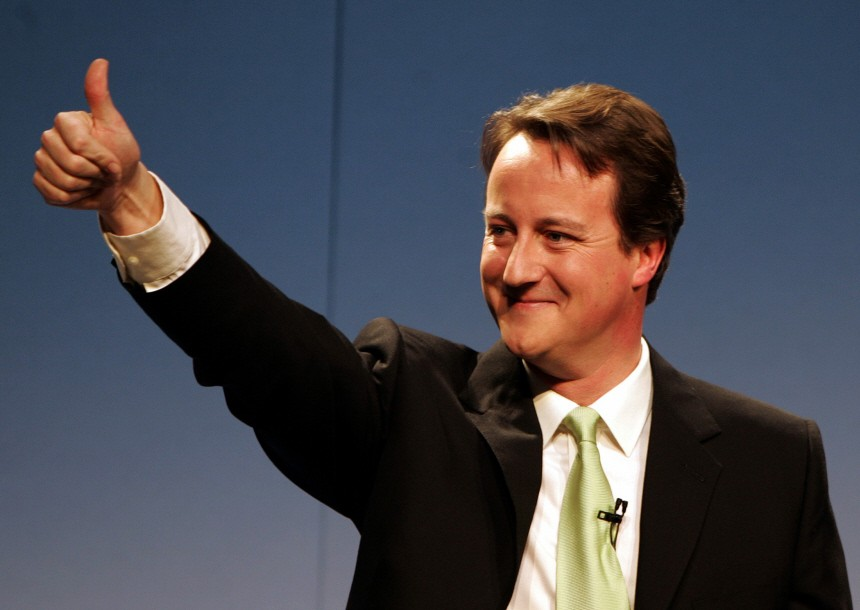Cameron gestures to supporters after being named as the new  Conservative party leader in London