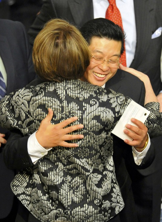 Tiananmen Square activist Yang Jianli of China hugs the speaker of the US House of Representatives Pelosi before the Nobel Peace Prize ceremony in Oslo