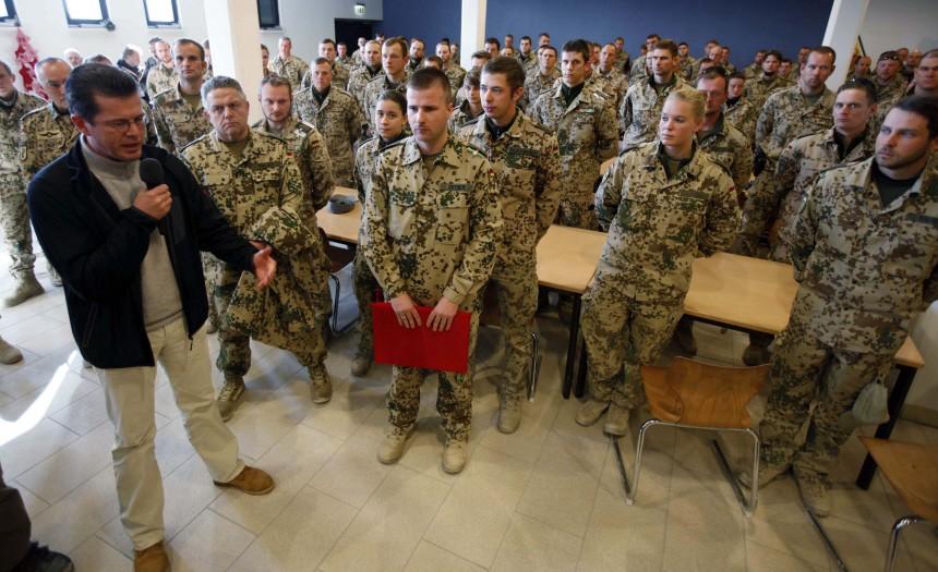 German Defence Minister zu Guttenberg talks to German Bundeswehr army soldiers before lunch during a visit to their army camp in Kunduz