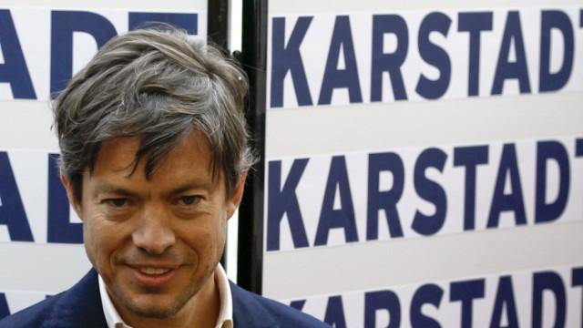 Billionaire Berggruen smiles during a news conference at a Karstadt store located on the Kurfuerstendamm boulevard in Berlin