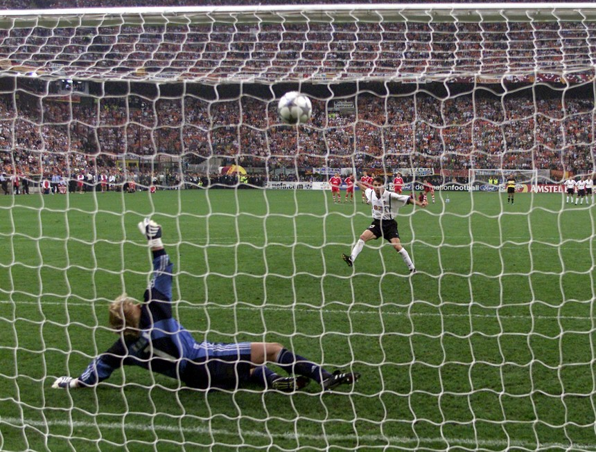 BAYERN MUNICH'S KAHN TIP CARBONI'S PENALTY ONTO THE BAR IN MILAN