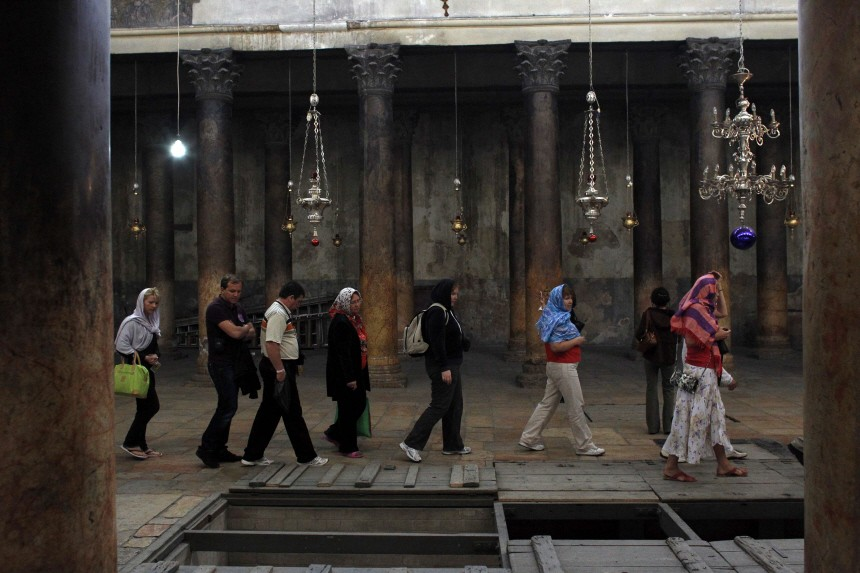 Tourists visit the Church of the Nativity in Bethlehem